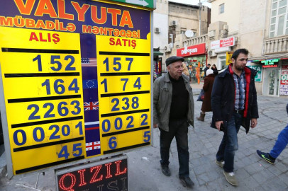 Azerbaijan considers tighter currency controls to staunch losses