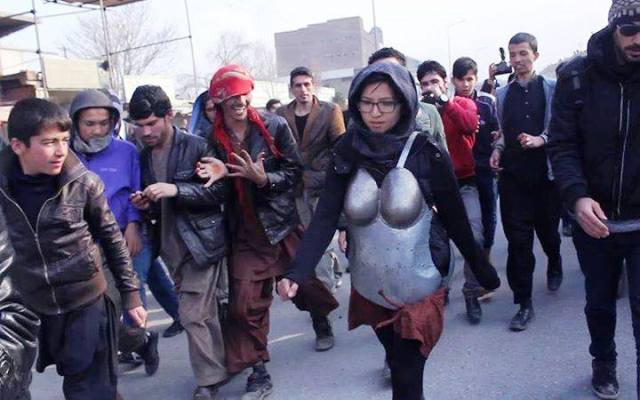 Woman in armour protesting against sexual harassment pelted with rocks
