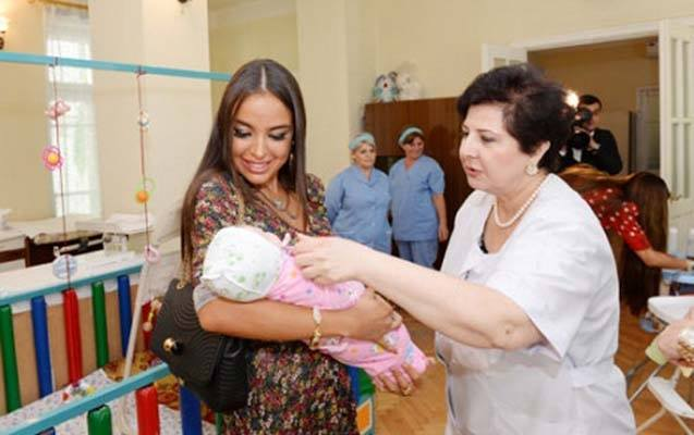 Azeri president's daughter adopts baby girl from local orphanage