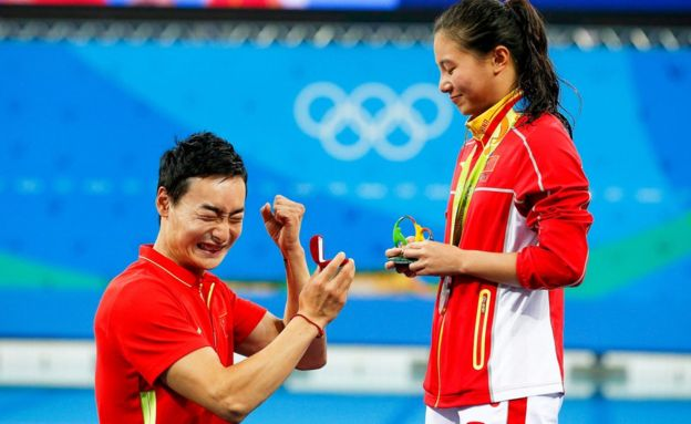 A marriage proposal at the Olympics medal ceremony