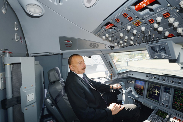 Azerbaijani president reviews first Embraer 190 plane of Buta Airways in Baku