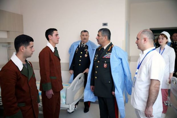 Azerbaijani defense minister visits military medical institutions (PHOTO)