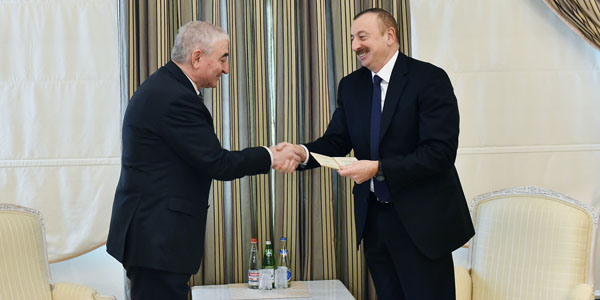 CEC Chairman Panahov presents presidential candidate certificate to Ilham Aliyev (PHOTO)