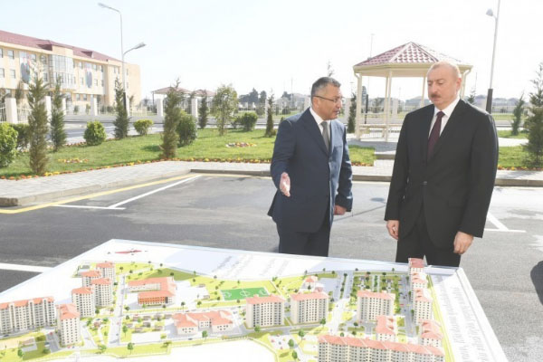 President Aliyev attends opening of new complex for IDP families in Baku's settlement (PHOTO)